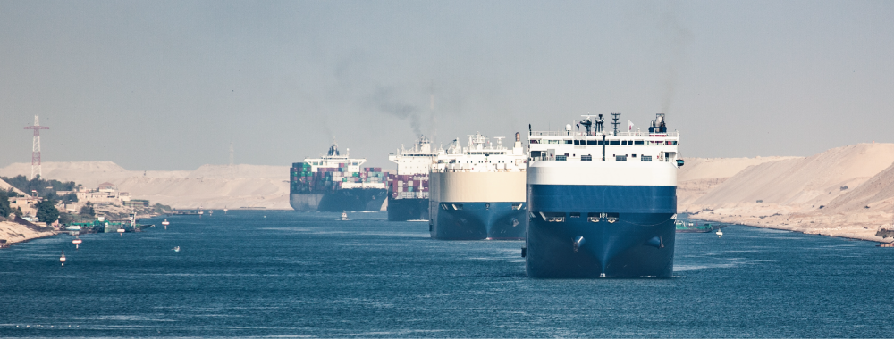 Image of large shipping vessels moving through the Suez Canal